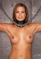 Chained to the wall playing dildo